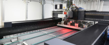 Laser structuring with micrometer accuracy for large and oversized substrates